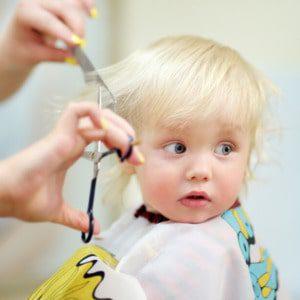 boy getting his hair cut done