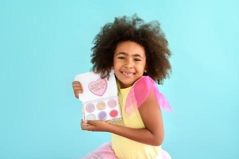 Girl showing oh flossy candy heart makeup set